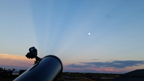 Moon with Sun's rays